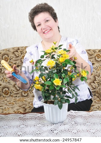 nice smiling woman with flower - stock photo