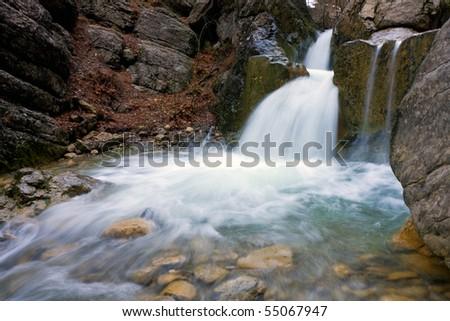 nice stream on mountain river - stock photo