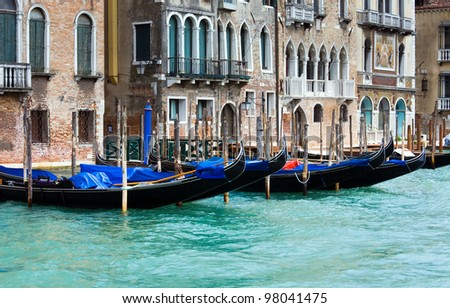Nice summer venetian Grand Canal view with gondolas on water (Venice, Italy)