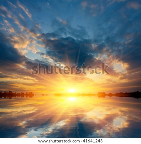 Nice sunset on lake - stock photo