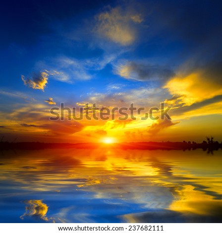 nice sunset over lake surface - stock photo