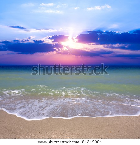 Nice sunset over sea beach - stock photo