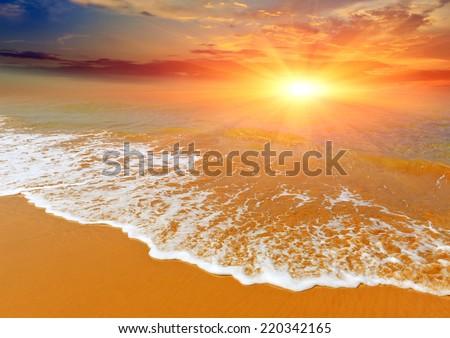 nice sunset over sea coast - stock photo