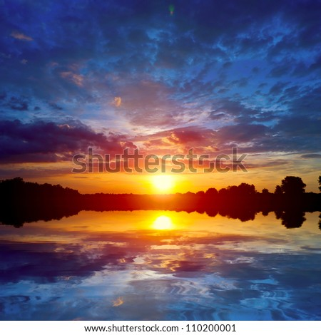 nice sunset scene on lake - stock photo
