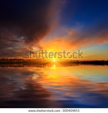 Nice sunset scene over lake water surface