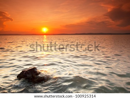 Nice sunset with a rock in the foreground
