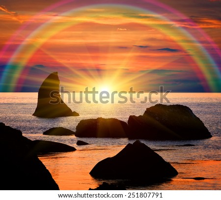 Nice sunset with raunbow scene on sea - stock photo