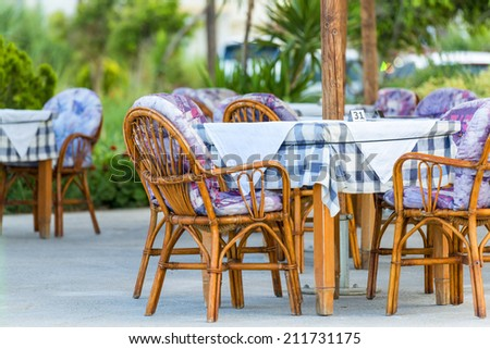 Nice Tables And Chairs In A Greek Tavern in Georgioupolis, Island of Crete, Greece