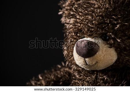 Nice teddy bear on black background - stock photo