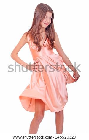 Nice teen girl in pink dress - stock photo