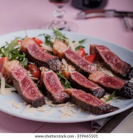 Nice tender steak with some vegetables - stock photo