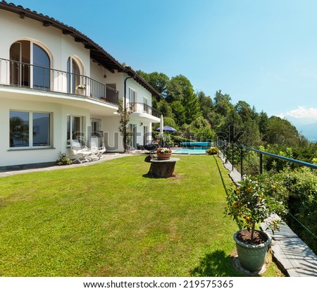 Nice terrace with swimming pool in a house, garden - stock photo