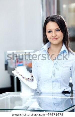 Nice the seller in shop of jewels - stock photo