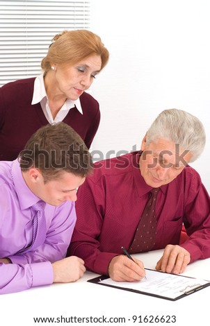 nice three business people sitting at table