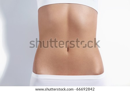 Nice tight belly on a white background - stock photo