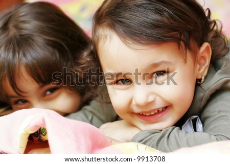 Nice two small girls looking at camera