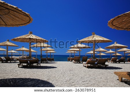 Nice vacation picture with beach parasols - stock photo