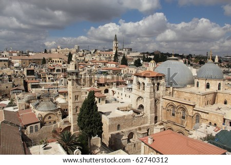 Nice view of the Christian Quarter of the Old City of Jerusalem. Holy Sepulcher against the blue sky and clouds. - stock photo