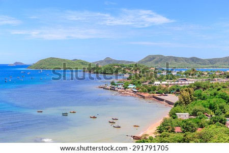 nice view of the fishing village and shore from top of hill in blue sky day