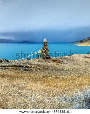 Nice view of the Tso Moriri lake near Karzok village in Rupshu valley against the background of cloudly sky. Tibet, Leh district, Ladakh, Himalayas, Jammu and Kashmir, Northern India - stock photo