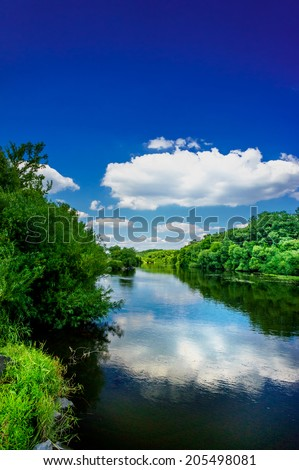 Nice view of wonderful river and blue sky. - stock photo