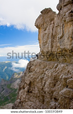 Nice view on mountain cottage surrounded by Dolomiti massifs - Dolomity di Brenta, Italy - stock photo
