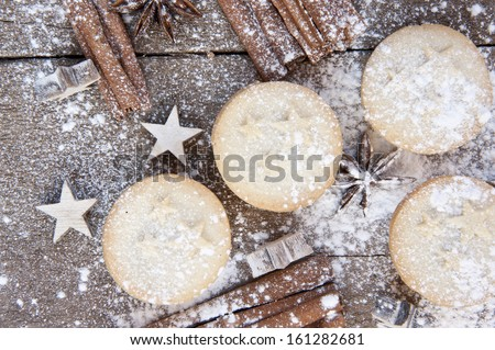 Nice warm cosy image of Christmas foods on grunge wooden background - stock photo