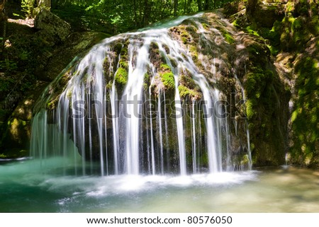 Nice waterfall in sunny day - stock photo