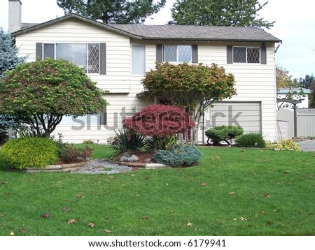 nice well kept house - stock photo