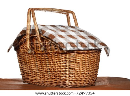 nice wicker picnic basket, white background - stock photo