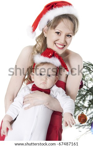 nice woman and baby in red christmas hats
