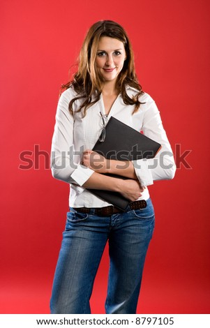 Nice woman holding a black folder before her chest. - stock photo