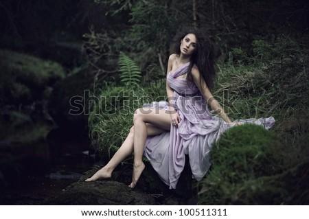 Nice woman in nature scenery - stock photo