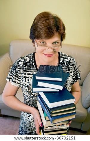 nice woman keeping the big pile of books