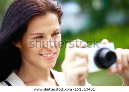 Nice woman making photo - stock photo