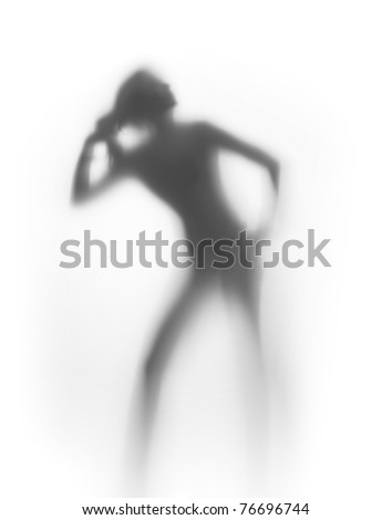 Nice woman pulls her hair, silhouette