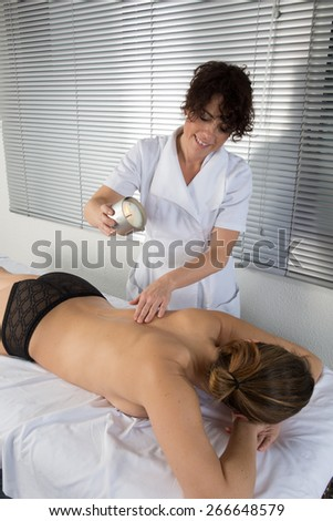 Nice woman Receiving a candle massage - stock photo