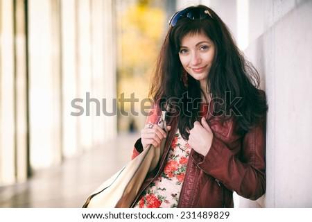 Nice woman with a handbag - stock photo
