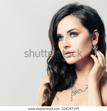 Nice Woman with Jewelry Diamond Necklace and Earrings - stock photo