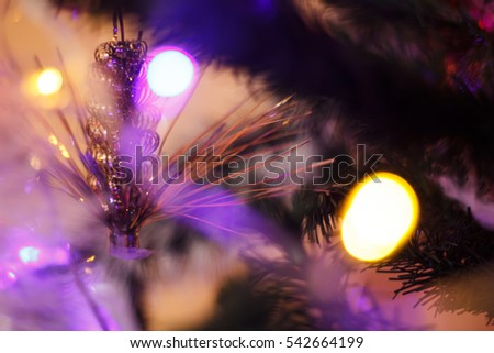 Nice xmas tree lights in tree, Christmas home room with tree and festive bokeh lighting, blurred holiday background.
