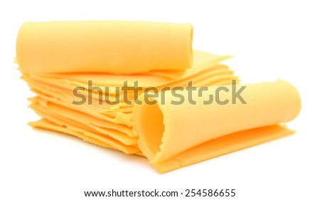 nice yellow cheese slices roll up isolated on white