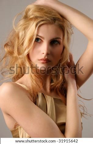 Nice young blond girl, closeup studio shot - stock photo
