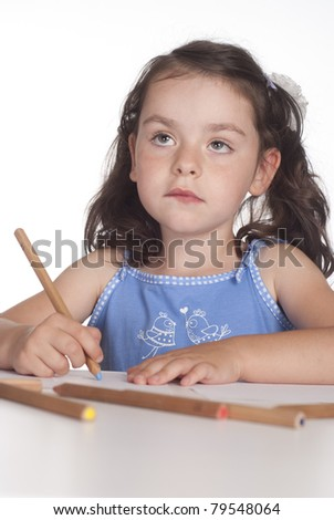 nice young girl drawing at table on a white - stock photo