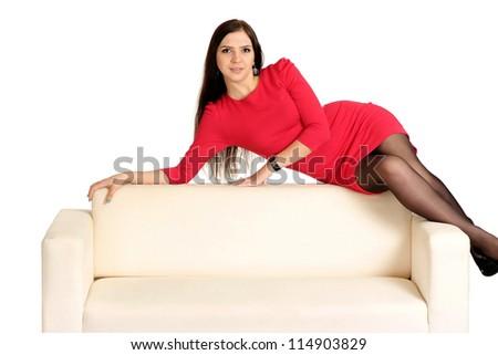 nice young girl on a white sofa - stock photo