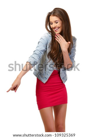nice young woman derides something at copyspace - stock photo