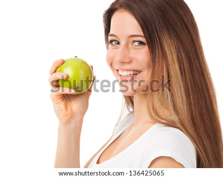 Nice young woman holding a green apple, isolated on white