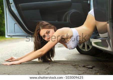 Nice young woman lying on the road - stock photo