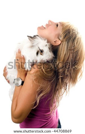 Nice young woman playing with little rabbit. Isolated