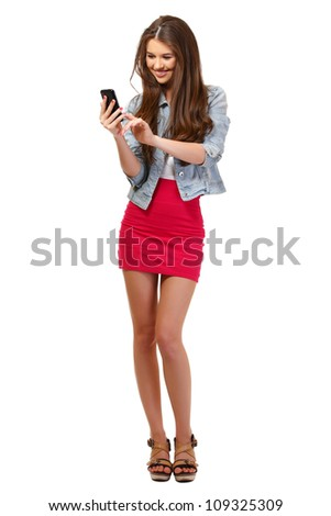nice young woman posing with phone in studio - stock photo