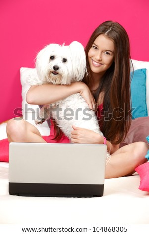 nice young woman smiling in her room - stock photo